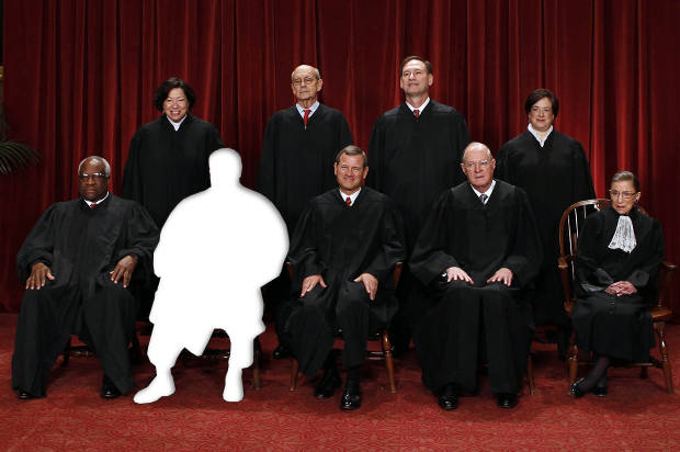 The justices of the U.S. Supreme Court minus Justice Antonin Scalia.(Credit: Reuters/Larry Downing/Salon)